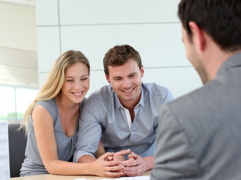 Financial confidence - Couple meeting with a financial advisor.