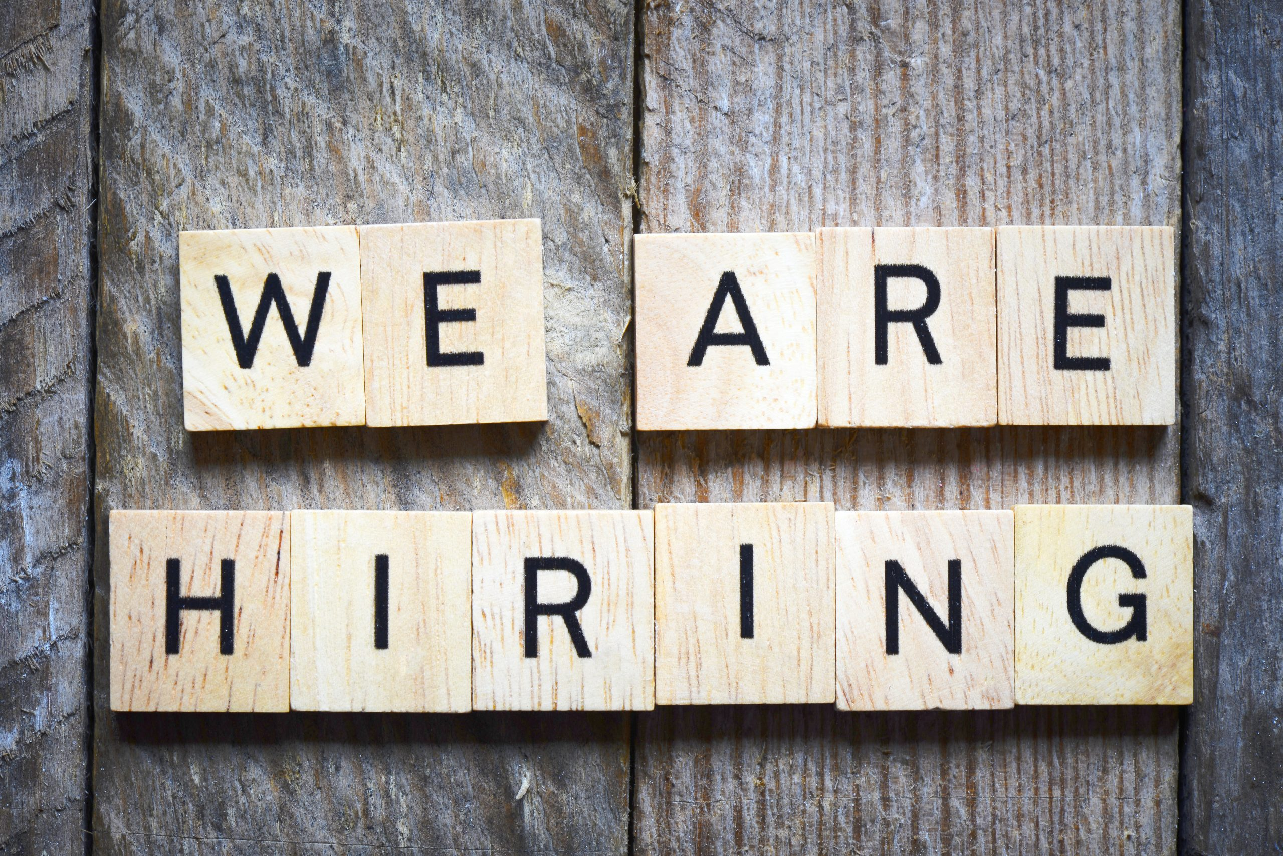 Wooden blocks spelling out: We are hiring