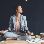 Business woman meditating in the office.