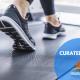 Starting a successful fitness program. Woman running/walking on the treadmill.