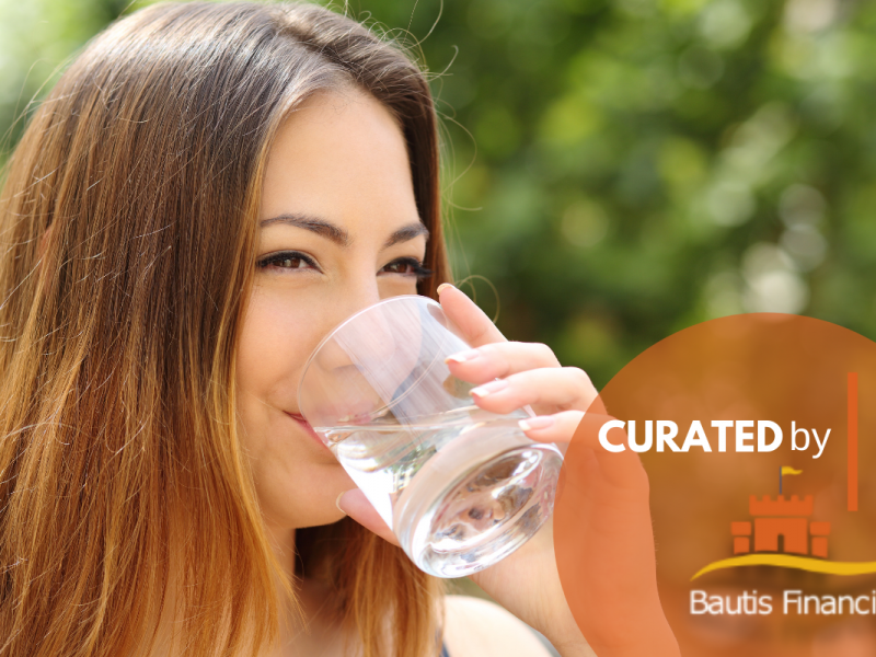 Woman drinking water and staying hydrated.